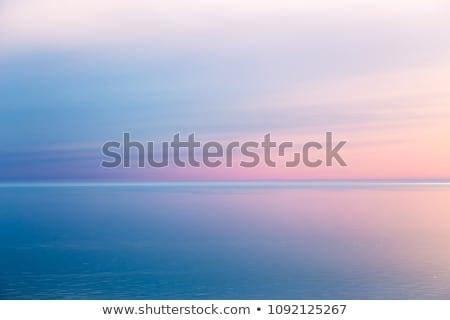 playa · puesta · de · sol · la · exposición · a · largo · mar · isla · Grecia - foto stock © badmanproduction