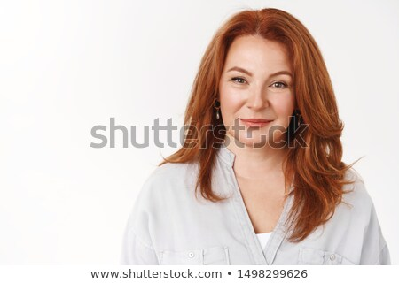 Redhead woman with fancy haircut Stock photo © konradbak