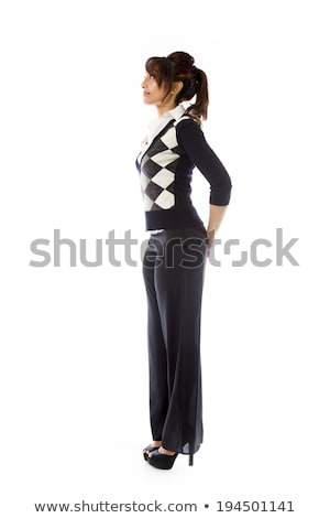 Side profile of an Indian young woman looking at distance with hands behind back Stock photo © bmonteny