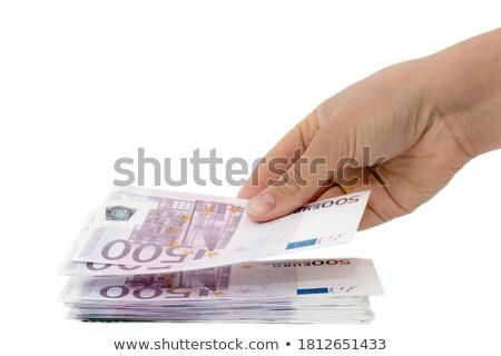 businesswoman holding euro banknotes on white background studio stock photo © ambro