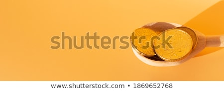 Wooden spoon with coins on a background of money Stock photo © Valeriy