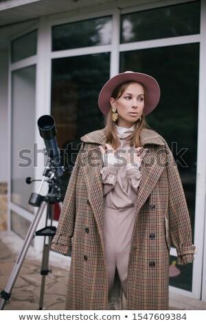 довольно улыбающаяся женщина позируют телескопом Сток-фото © stryjek