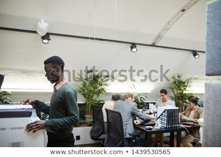 Businessman scanning and printing document  Stock photo © HASLOO