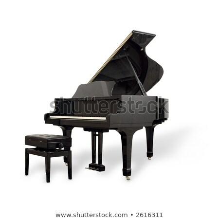 Echt zwarte vleugelpiano geïsoleerd witte toetsenbord Stockfoto © ozaiachin