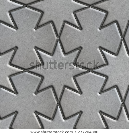 gray paving slabs laid in the form of stars and crosses stock photo © tashatuvango