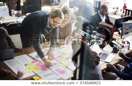 Negocios interacción oficina de trabajo portátil Screen Foto stock © tashatuvango