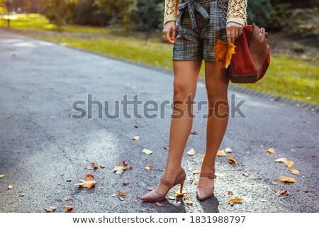 Legs and extravagant high heels standing Stock photo © roboriginal