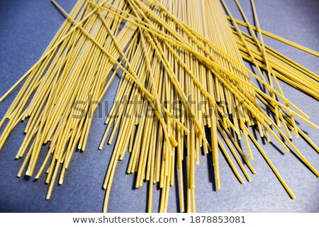 long pasta raw isolated on black table stock photo © dla4