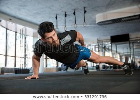 портрет фитнес человека мускулистое тело позируют черный Сток-фото © deandrobot