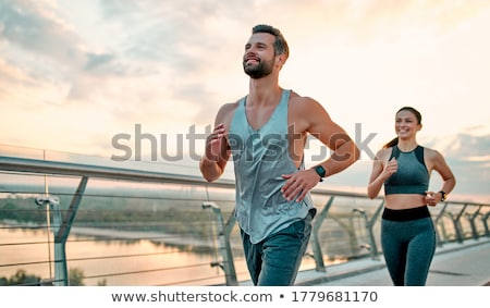 Athletic couple Stock photo © alphaspirit