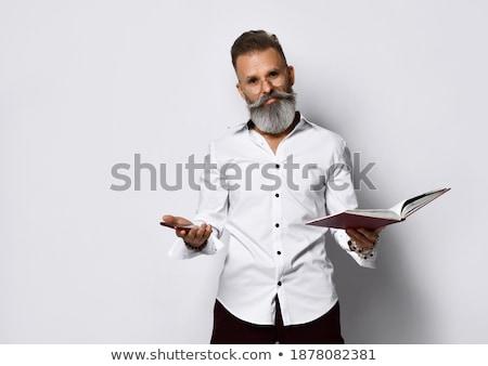 Férfi pontok ujj érdekes könyv kéz Stock fotó © Patramansky