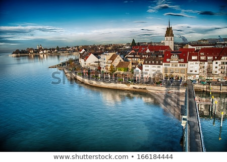 bodensee lake constance with schlosskirche church of friedrichshafen at sunset germany stock photo © fisfra