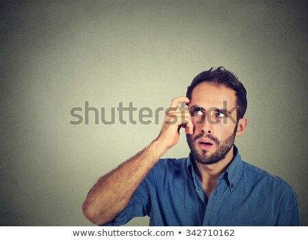 closeup portrait of a man wondering about something Stock photo © feedough