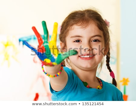 Joyful five year old playing in paint Stock photo © ozgur