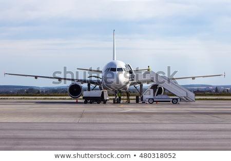 Repülőgép repülés égbolt felhők utazás repülőtér Stock fotó © bluering