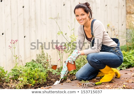 Boldog kertész gereblye tart fehér fa Stock fotó © bluering