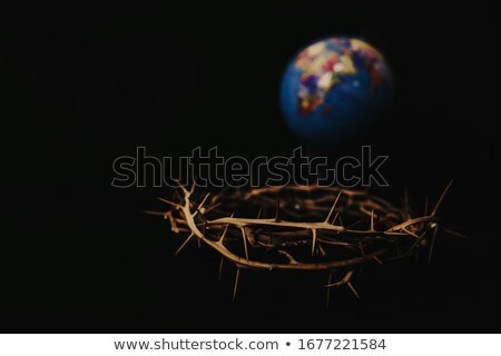 bronze statue of jesus christ crucified on a cross in a church stock photo © bubutu