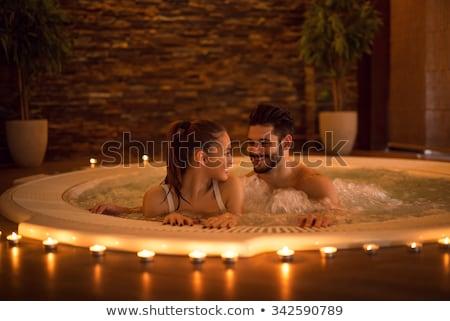 пару джакузи счастливым расслабляющая отпуск женщину Сток-фото © Kurhan