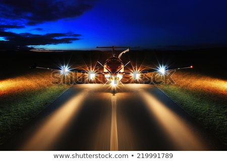 back of airplane flying at night stock photo © bluering