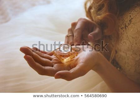 Mulher jovem perfume garrafa isolado branco menina Foto stock © Elnur