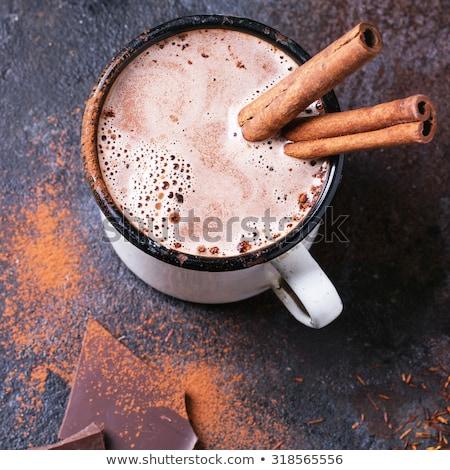 cup of hot chocolate cinnamon sticks stock photo © mady70