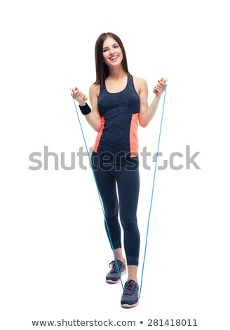 woman standing in the gym and holding rope Stock photo © chesterf