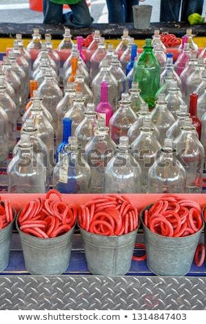 Rows of Bottles for Ring Toss Stock photo © BrandonSeidel