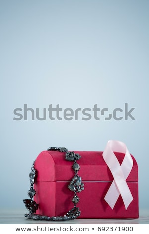 Pink Breast Cancer Awareness ribbon and jewelry on red box Stock photo © wavebreak_media