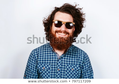 bearded hipster man wearing sunglasses standing isolated stock photo © deandrobot