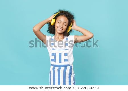 casque · écouter · de · la · musique · hiver · vêtements - photo stock © godfer