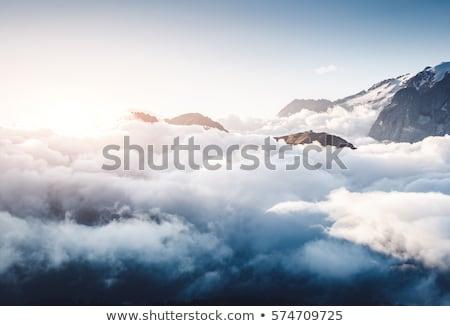 Creamy fog covered the glacier Marmolada. Location place Val di  Stock photo © Leonidtit