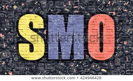 multicolor smo on dark brickwall doodle style stock photo © tashatuvango