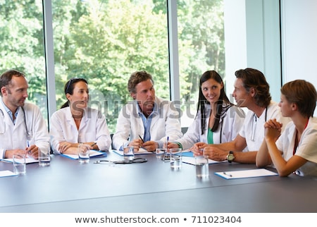 Doctors meeting to discuss files Stock photo © IS2