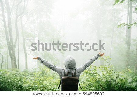 A girl with his arm raised Stock photo © IS2
