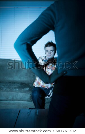 Young man watching tv, woman blocking view Stock photo © IS2