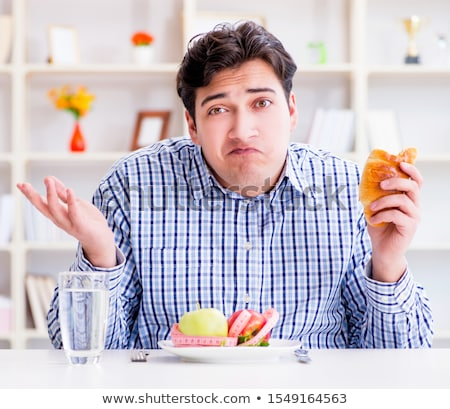 man having dilemma between healthy food and bread in dieting con stock photo © elnur