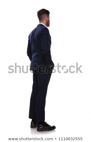turned businessman in navy suit looks to side Stock photo © feedough