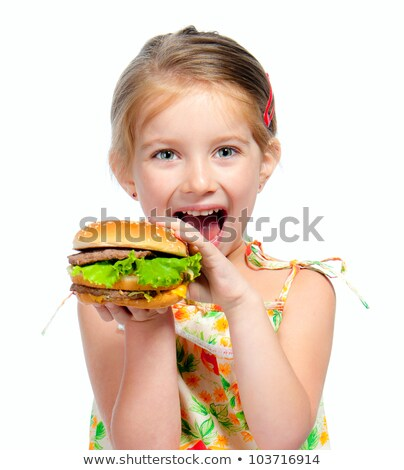 Little caucasian girl eating a hamburger. Stock photo © RAStudio