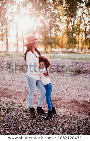 Portrait of pretty young afro american woman Stock photo © deandrobot