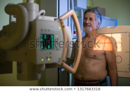 Healthcare Concept - Senior male patient undergoing an X-ray examination Stock photo © lightpoet