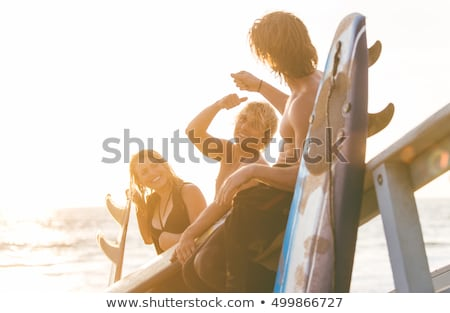 Genç sörfçü plaj siluet yerel erkek Stok fotoğraf © joyr