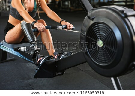 Cropped photo of fitness disabled woman in tracksuit working out Stock photo © deandrobot