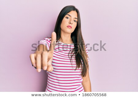 Close up image of Displeased brunette woman in casual clothes Stock photo © deandrobot