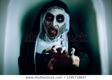 frightening evil nun in a black and white habit stock photo © nito