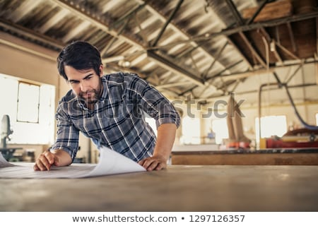 carpenters with blueprint at workshop Stock photo © dolgachov