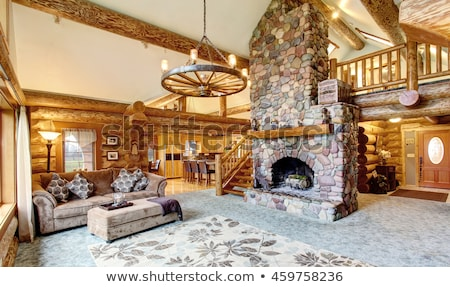 Living room interior with real stone fireplace and wooden beams. Stock photo © iriana88w