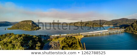 Central costa ponte rio céu Foto stock © lovleah