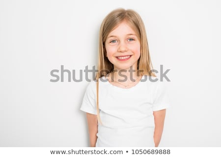 Happy small five years old girl with straight hair over white background at home Stock photo © Lopolo