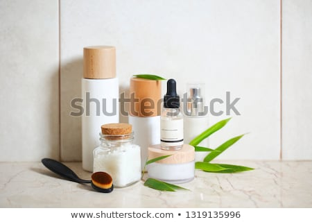 Face cream, serum, lotion, moisturizer and sea salt  among bambo Stock photo © dashapetrenko