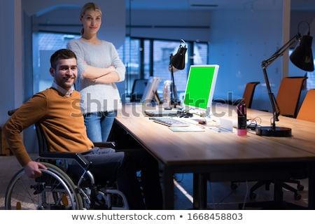 Feminino empregado cadeira de rodas escritório negócio papel Foto stock © Elnur